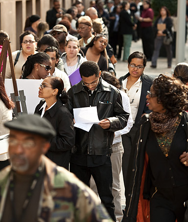 Job seekers wait on line outside the Metropolitan Pavilion before the start of a job fair in New York, U.S., on Sunday, Oct. 2, 2011.