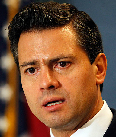 Mexican Gov. Enrique Pena Nieto answers reporters' questions at the National Press Club in Washington November 15, 2011.