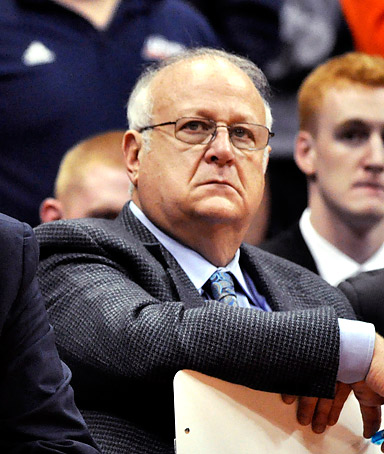 In this Monday, Nov. 14, 2011, photo, Syracuse basketball assistant coach Bernie Fine watches a college basketball game against Manhattan in the NIT Season Tip-Off in Syracuse, N.Y.
