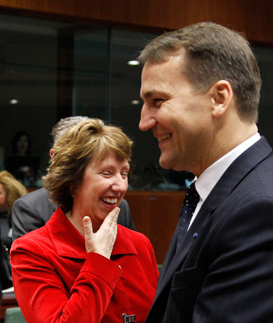 Poland's Foreign Minister Radoslaw Sikorski (R) chats with European Union's foreign policy chief Catherine Ashton (L) at the start of an European Union foreign ministers meeting at the EU Council headquarters in Brussels November 14, 2011