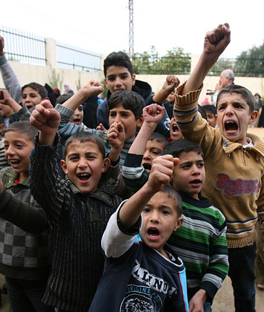 Syrian refugee children chant slogans at an abandoned school in the Wady Khaled area, northern Lebanon November 12, 2011
