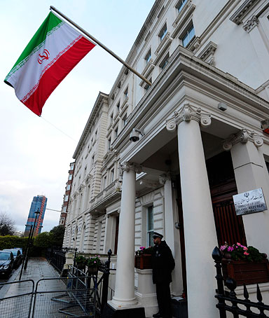A police officer stands guard outside the Iranian embassy in central London, on November 30, 2011