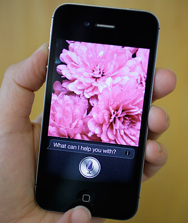 In this photo taken Monday Oct. 10, 2011, Siri, the new virtual assistant, is displayed on the new Apple iPhone 4S in San Francisco.