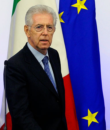 Italy's Prime Minister Mario Monti arrives to lead a news conference to illustrate the new austerity package in Rome, December 4, 2011