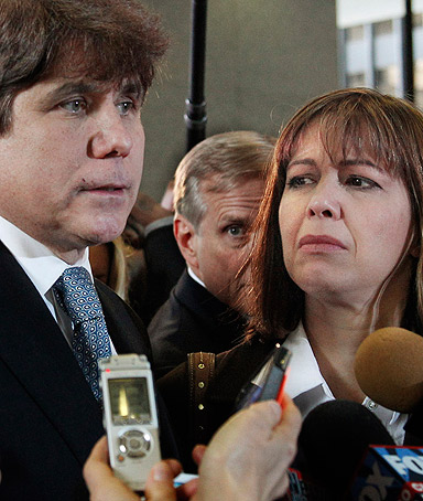 Former Illinois Gov. Rod Blagojevich, left, speaks to reporters as his wife Patti, center, listens at the federal building in Chicago,  Dec. 7, 2011