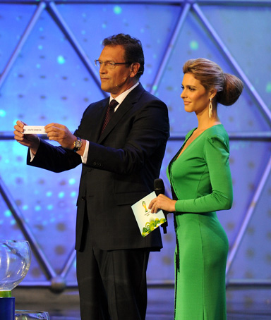 FIFA's Secretary General Jerome Valcke (L) draws South America next to Brazilian actress and model Fernanda Lima, during the Preliminary Draw for the 2014 FIFA World Cup Brazil, on July 30, 2011, at the Marina da Gloria, in Rio de Janeiro, Brazil