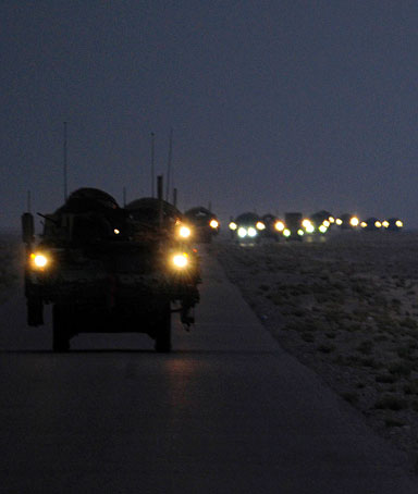 A line of Strykers convoy drives through Iraq as they leave for Kuwait in the early hours of Aug. 16, 2010