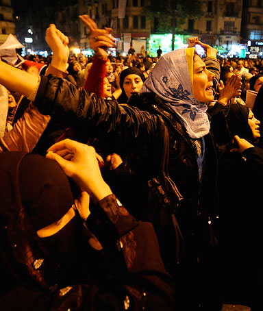 Egyptian women shout slogans during a protest in downtown Cairo's Tahrir Square to denounce the military's attacks on women and to call for an immediate end to the violence against protesters on December 20, 2011