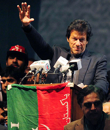 Pakistani cricket hero turned politician Imran Khan gestures as he addresses supporters during a public meeting gathering over 100,000 people in Karachi on December 25, 2011