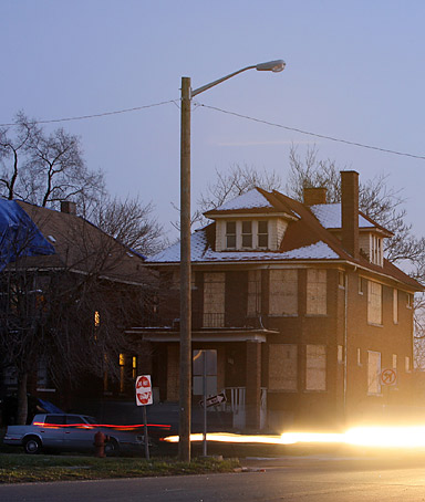 A lone streelight, one that survived the mass removal of streetlights this year to save the city money, in Highland Park, Mich., Dec. 7, 2011.