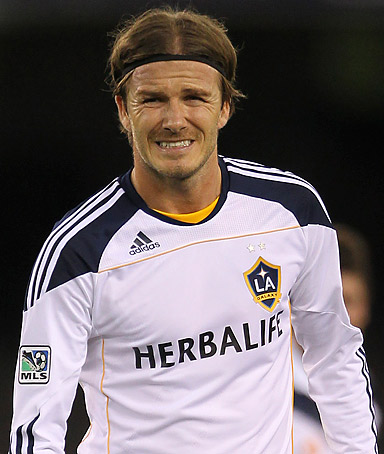 LA Galaxy's David Beckham of England grimaces during their friendly match against Melbourne Victory at Etihad Stadium in Melbourne, December 6, 2011.