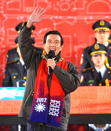 Taiwan President Ma Ying-jeou (C) waves to the crowd during a flag-raising ceremony on the square of the Presidential Office in Taipei on January 1, 2012