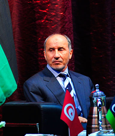 Libya's National Transitional Council leader Mustafa Abdel Jalil (R) listens as Tunisia's President Moncef Marzouki speaks during a meeting with civil society institutions in Benghazi January 3, 2012