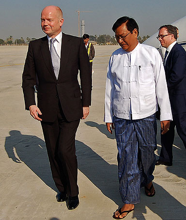 British Foreign Secretary William Hague (L) walks on the tarmac upon his arrival at Naypyidaw airport at the start of a historic visit to Burma on January 5, 2011