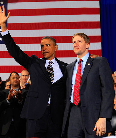 U.S. President Barack Obama waves with Richard Cordray (R) after announcing that he has appointed Cordray to head the Consumer Financial Protection Bureau during a trip to Cleveland, Ohio January 4, 2012