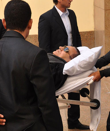 Former Egyptian president Hosni Mubarak is wheeled into a court house in Cairo, Egypt, Jan. 3, 2012