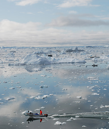 A picture taken on July 3, 2009 shows a fisherman sailing on the Ice Fjord of Ilulissat in Greenland.