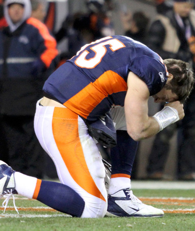 Denver Broncos quarterback Tim Tebow prays after the Broncos defeated the Pittsburgh Steelers in overtime in the NFL AFC wildcard playoff football game in Denver, Colorado, January 8, 2012