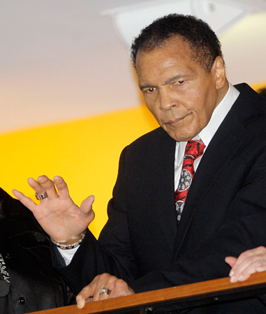 Boxing great Muhammad Ali, with his wife, Lonnie, right, waves to friends attending a celebration for his 70th birthday at the Muhammad Ali Center on Saturday, Jan. 14, 2012, in Louisville, Ky
