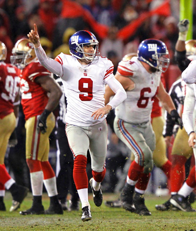 New York Giants kicker Lawrence Tynes (9) and holder Steve Weatherford (5) celebrate with teammates after Tynes kicked the winning field goal against the San Francisco 49ers in overtime