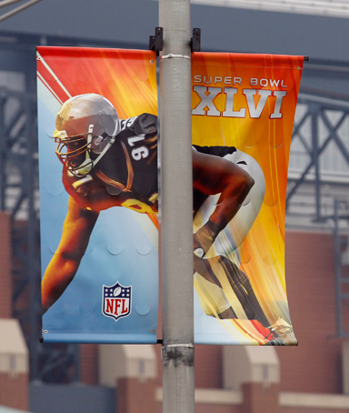 Banners hang on light poles near Lucas Oil Stadium as preparations continue for Super Bowl XLVI in Indianapolis, Monday, Jan. 23, 2012