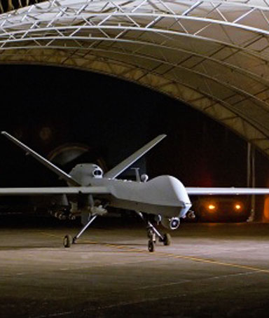 An MQ-9 Reaper remotely piloted aircraft prepares to taxi out of a hangar at Joint Base Balad in Iraq.