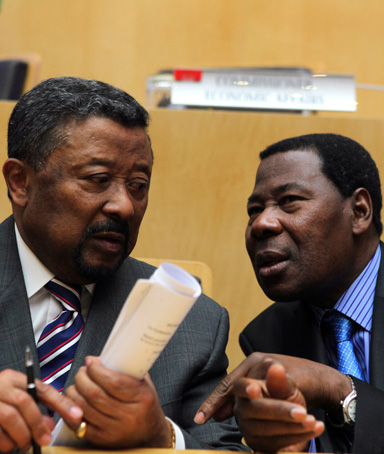 African Union Commission Chairman Jean Ping (L) and Benin's President Thomas Boni Yayi, newly elected African Union president, talk shortly after the closing ceremony of the 18th African Union (AU) summit in Ethiopia's capital Addis Ababa January 31, 2012