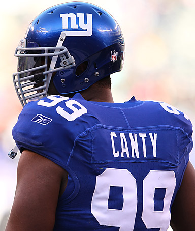 Chris Canty #99 of the New York Giants looks on before the game against the Washington Redskins during their game at MetLife Stadium on December 18, 2011 in East Rutherford, New Jersey.