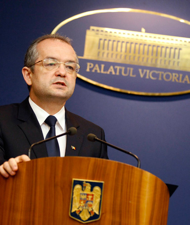 Romania's Prime Minister Emil Boc addresses the media during a news conference at Victoria Palace in Bucharest, in this file picture taken January 16, 2012