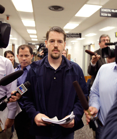 In this Sept. 23, 2011 file photo, Josh Powell is surrounded by reporters as he leaves a Pierce County courtroom in Tacoma, Wash.