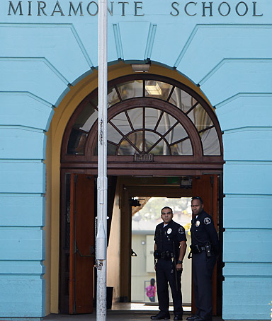 In this Tuesday, Jan. 31,2012 file photo police are seen at the the Miramonte Elementary school in Los Angeles.