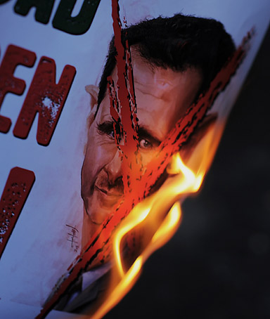 Protesters set on fire a placard in Turkish that reads