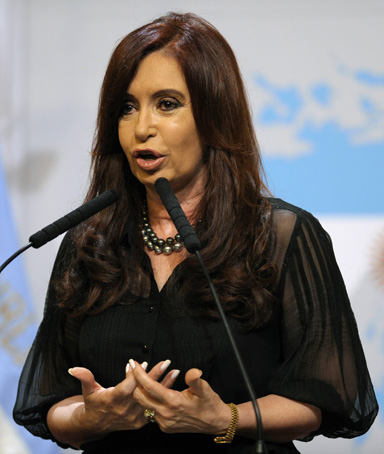Argentine President Cristina Fernandez de Kirchner delivers a speech in front of a backdrop displaying the Falkland Islands (Malvinas in Spanish) painted like the Argentine national flag at the Government Palace in Buenos Aires on February 7, 2012