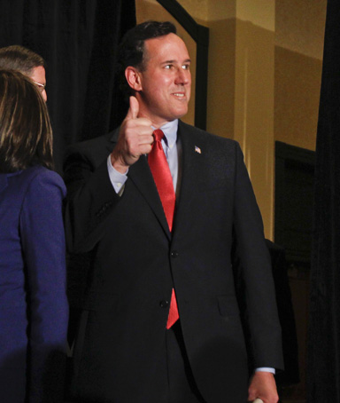 U.S. Republican presidential candidate and former U.S. Senator Rick Santorum gives a thumbs up gesture as he arrives at his primary night rally at the St. Charles Convention Center in St. Charles, Missouri, February 7, 2012