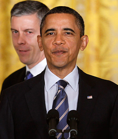 Education Secretary Arne Duncan applauds prior to President Barack Obama speaking about No Child Left Behind, Thursday, Feb. 9, 2012, in the East Room of  the White House in Washington.