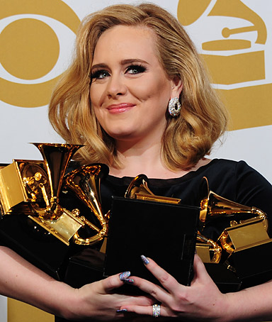 Musician Adele poses with her six trophies at the 54th Grammy Awards in Los Angeles, California, February 12, 2012.