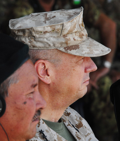 U.S. General John Allen, commander of the NATO-led International Security Assistance Force (ISAF) in Afghanistan General (R) looks on alongside Major General Ali Murad (L) Chief of Defence of Afghanistan