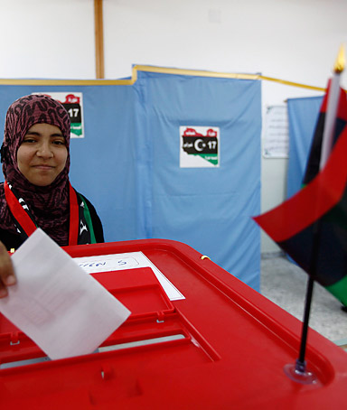 A woman casts her vote during the local council election in Misrata February 20, 2012.