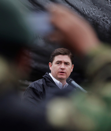 A soldier takes a picture of Nuevo Leon State Governor Rodrigo Medina during a graduation ceremony of cadets from the Fuerza Civil (Civil Force) at the 7th military zone on the outskirts of Monterrey February 11, 2012