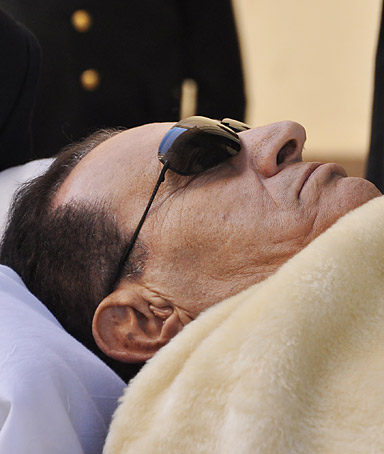 In this Saturday, Jan. 21, 2012 photo, former Egyptian president Hosni Mubarak is wheeled into a court house in Cairo, Egypt.