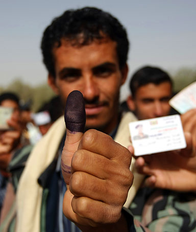 A Yemeni man shows his ink-stained thumb after he voted in the presidential election in Sanaa on February 21, 2012 that brings an end to President Ali Abdullah Saleh's 33-year hardline rule in Yemen