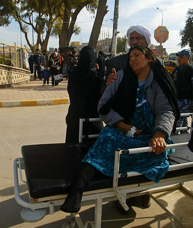A wounded Iraqi woman is wheeled to a hospital following a blast in the northern city of Kirkuk on February 23, 2012.