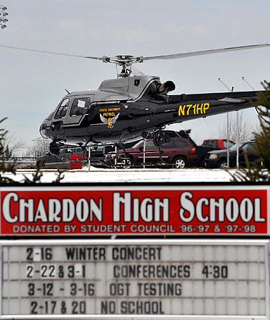 An Ohio State highway patrol helicopter prepares to leave the grounds of Chardon High School in Chardon, Ohio February 27, 2012.