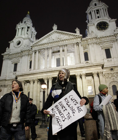 Occupy London protesters stands outside St Paul's Cathedral in London after bailiffs moved in to remove tents from the anti-capitalist Occupy London camp, Tuesday, Feb. 28, 2012
