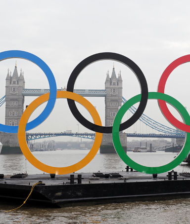 Giant Olympic Rings, measuring 11m high and 25m wide, are launched on a barge onto the River Thames, in London, on February 28, 2012, as organisers celebrate 150 days to go until the start of the 2012 London Olympics