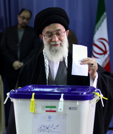 A handout picture from the official website of the Iranian Supreme Leader Ayatollah Ali Khamenei shows him casting his ballot during a parliamentary vote in Tehran on March 2, 2012