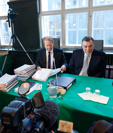 Iceland's ex-prime minister Geir Haarde (R) smiles next to his lawyer Andri Arnason on March 5, 2012 in Reykjavik's court during his trial over his role in the 2008 banking sector collapse that brought his country to its knees