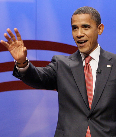 Democratic presidential candidate, Sen. Barack Obama, D-Ill., waves before speaking at the Service Nation Summit at Columbia University in New York, Thursday, Sept. 11, 2008.