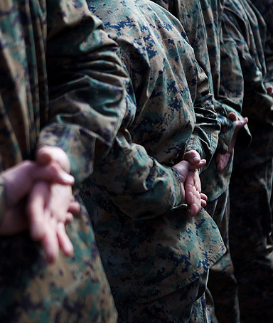 U.S. Marines stand at attention before a service held in honor of Lance Cpl. Donald Hogan January 17, 2012 in Camp Pendleton, California.