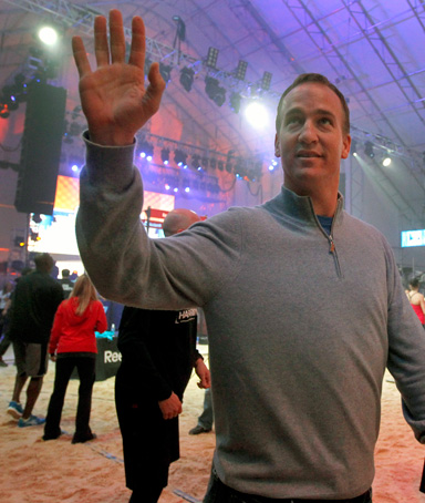 Indianapolis Colts quarterback Peyton Manning waves to the crowd as he arrives for the Celebrity Beach Bowl, part of NFL football's Super Bowl XLVI festivities, Saturday, Feb. 4, 2012, in Indianapolis